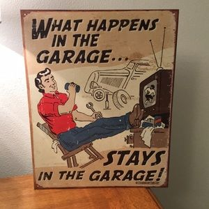 WHAT HAPPENS IN THE GARAGE STAYS IN THE...Tin Sign